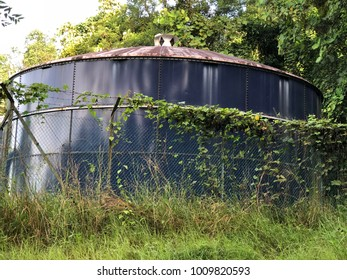 A black water storage tank placed by the hill located in Tamparuli, Sabah, Malaysia.