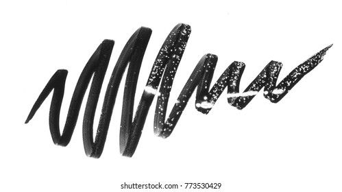 Black wavy lines made with  eyeliner isolated on a white background