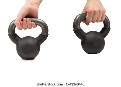 Black weight isolated on white in woman hand. 4 kg weight. Fitness for women.