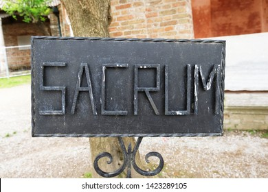 black welded sacrum sign in Torcello, Italy