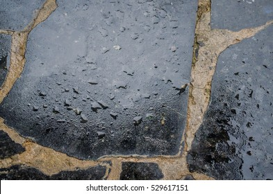 black wet granite tiles with water drops pile of granite texture - marble layers design gray stone slab surface grain rock backdrop layout