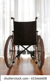 black wheelchair in the hospital room without person