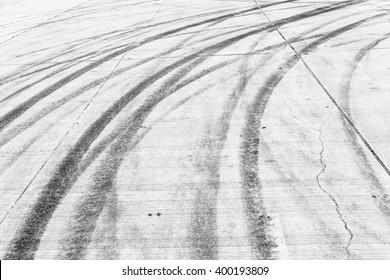 Black and White Abstract car skid marks on concrete asphalt. Automobile burnout skid marks on urban street.
