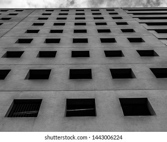 Black and white abstract view of a large parking garage.