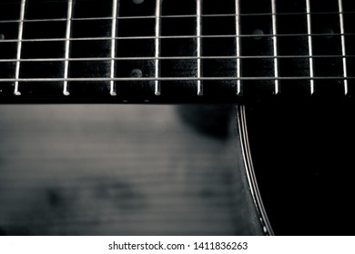 Black and white acoustic guitar.