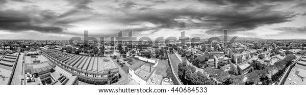 Black and white aerial view of Pisa, northwestern side with Miracles Square on background.