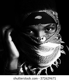Black and White African American Man portraying to be a evil gangster , terrorist, burglar,  suspicious , hip hop and hooligan.
