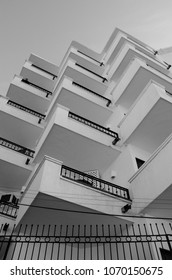 Black and white apartment building balconies.