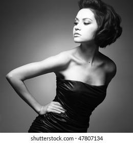 Black and white art photo. Elegant lady with stylish short hairstyle.