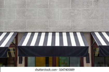 black and white awning over the glass window of shop, canvas shading decoration for coffee shop
