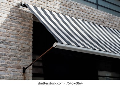 black and white awning over a window
