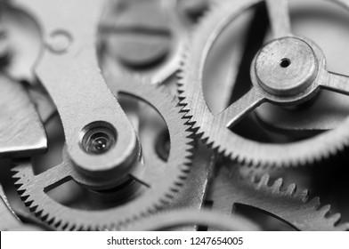 Black and white Background with metal cogwheels clockwork. Concept Teamwork. Macro.