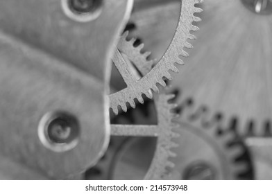Black white background with metal cogwheels a clockwork.Rather unique macro photo, for your successful business design. Extreme closeup. Macro