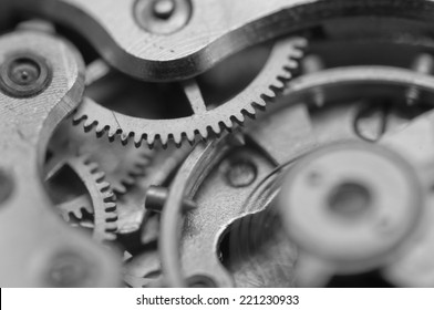 Black white background with metal cogwheels a clockwork. Conceptual photo for your successful business design. Macro