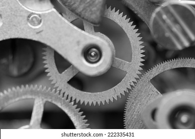 Black and white background with metal cogwheels a clockwork. Conceptual photo for your successful business design. Macro