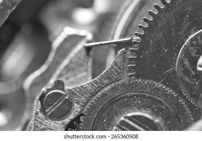 Black white Background with metal cogwheels a clockwork. Macro. Conceptual photo for your successful business design or technological process