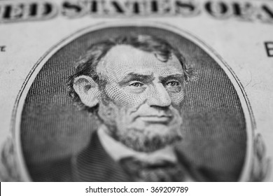 black and white background of money, five dollar bills front side. background of dollars, close up, President Abraham Lincoln on the dollar bill