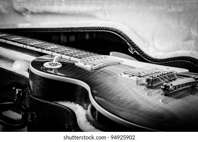 Black and White of Beautiful Electric Guitar Laying in a Hard Shell Guitar Case