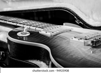Black and White of a Beautiful Electric Guitar Laying in a Hard Shell Guitar Case