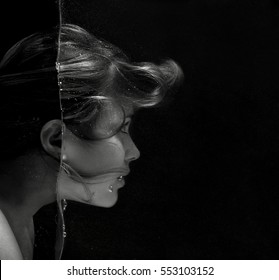black and white beautiful fashion fantastic portrait of face of a woman peering into the water dive with all head