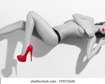 black and white beauty portrait of nude girl with red lips and red heeled shoes.Sexy Beautiful naked woman