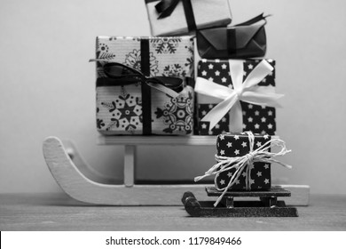 black white big and small christmas sledges with presents