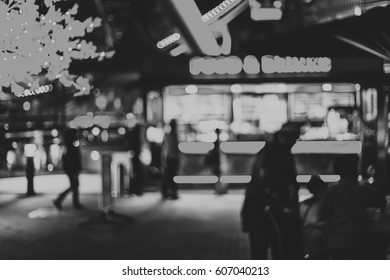 Black and white bokeh city street at night