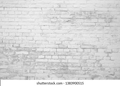 Black and white brick texture with scratches and cracks. Old vintage brick wall pattern. Brick work background.