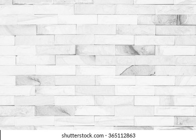 Black and white brick wall art concrete or stone texture background in black, grey and colors or wallpaper abstract paint to flooring and homework.