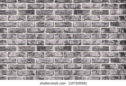 Black and white brick wall background. Texture from bricks. Old vintage brick background,