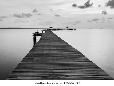 Black and white of Bridge on beach in sunrise and sea wave in Rayong, Thailand