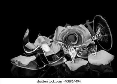 Black and white of broken glass and a broken rose