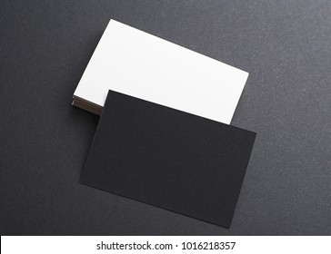 Black and white business card on black background. Mockup.