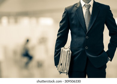 black and white businessman hold data files in office