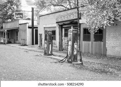 Black and white cafe and grunge service station with rusty fuel tanks in rural Utah, USA.