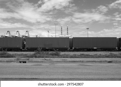 Black and white cargo train platform with container