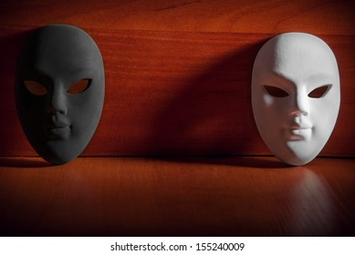 Black and white carnival mask on a wooden background with the space.