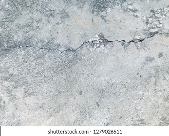 Black and white cement ground background and pattern. It is cracked of concrete street road and very fractious. The damage is caused by the impact and vibration of the ground and long-time use