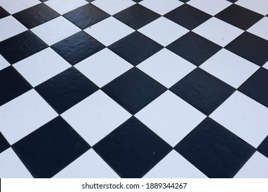 Black and white checkerboard floor background.
