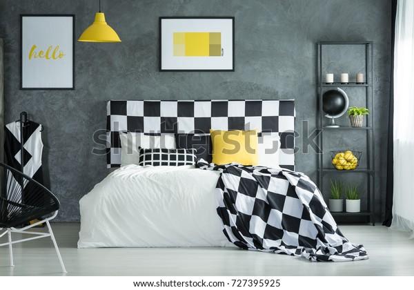 Black White Checkered Bedsheets Yellow Pillow Stock Photo ...