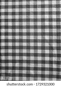 Black and white checkered fabric background.