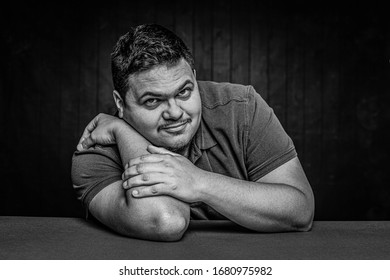 Black and white cheerful Latino man in a casual pose