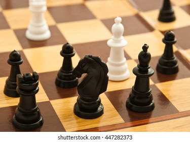 black and white chess figures on a board