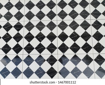 Black and white chess pattern tiles.Big black and white checkered pattern tiles. The floor tiles are a checkered pattern in black and white
