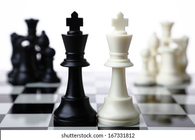Black and white chess pieces merging together on white background