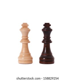 Black and white chess pieces on a white background