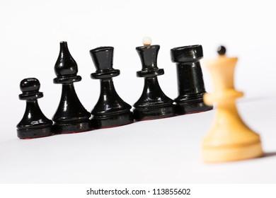 Black and white chessmen on white