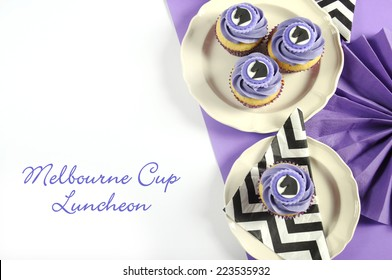 Black and white chevron with purple theme party luncheon table place setting for Melbourne Cup, Australian public holiday, horse race event cupcakes with closeup and sample text.