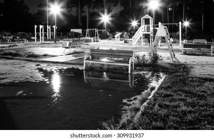 black and white children's playground in  courtyard at night