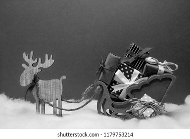 black white christmas deer with sledges and presents festive mood